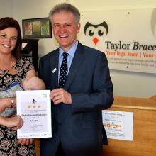 Lauren Smith and baby Greyson with John Coulthurst from British Red Cross